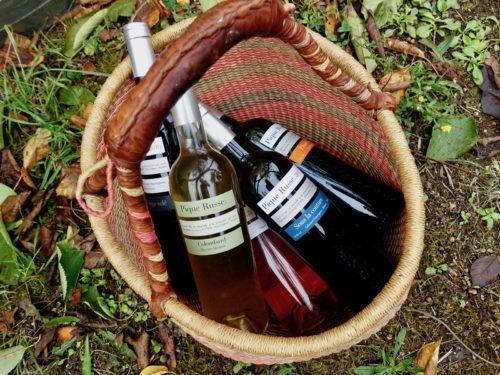 Basket of Pique Russe wine bottles